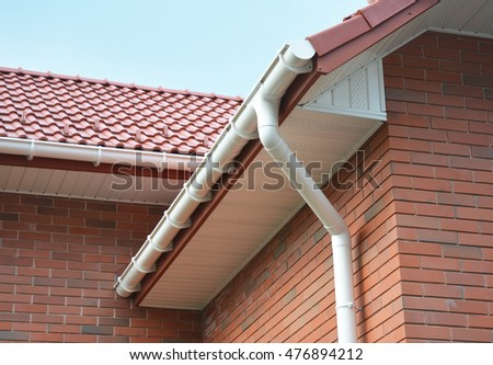 Close up view on House Problem Areas for Rain Gutter Waterproofing Outdoor. Home Guttering, Gutters, Plastic Guttering System, Guttering & Drainage Pipe Exterior