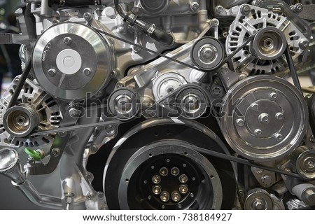 Close up view on new truck diesel engine motor belt, pulleys, gears, alternator and other engine equipment. Assembled truck diesel engine. Abstract auto automotive industrial background pattern #738184927