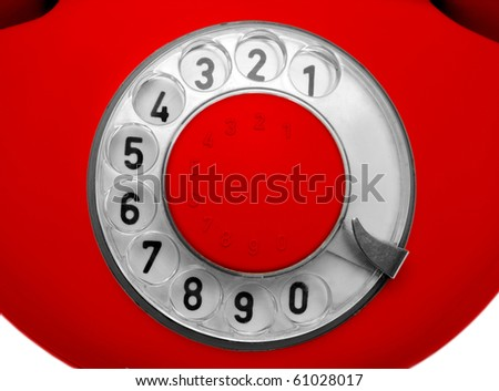 close-up view on old red telephone dial - stock photo