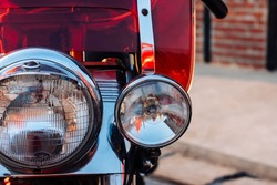Close-up view on retro motorcycle headlights.