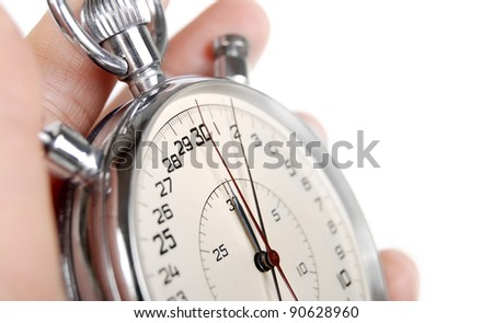 Close up view on the arrows of stopwatch  in hand