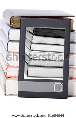 Close-up view to portable book reader (e-book) and stack of big paper books. Studio shot, not isolated