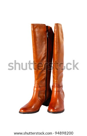 Close-up view to woman autumn boots on white background