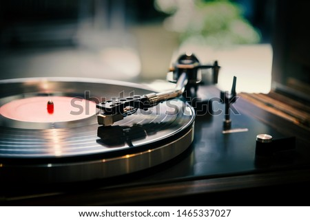 Close-up, vintage record player, While playing the record, Black platter.