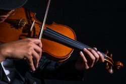 Close up Violin player in dark studio, Musical concept