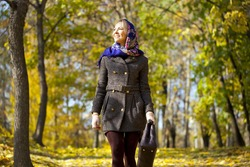 Close up, walking happy woman in autumn park
