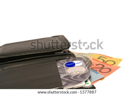 "Close-up wallet, credit card displays ""Credit Debt"" with Australian $10, $20 & $50 notes"