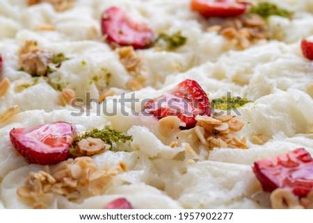 Close-up walnut gullac dessert. Traditional Ramadan dessert. Middle Eastern desserts. Local name güllaç dessert