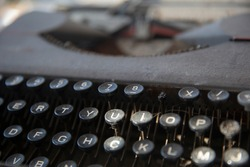 close-up weathered antique typewriter. Selective focus