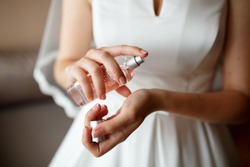 Close-up wedding details. Jewelry and parfumes. bride's hands