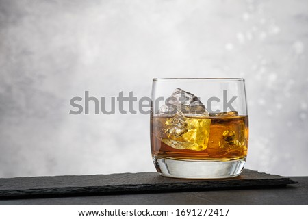 Close-up whiskey with ice cubes on gray background with copy space ストックフォト ©