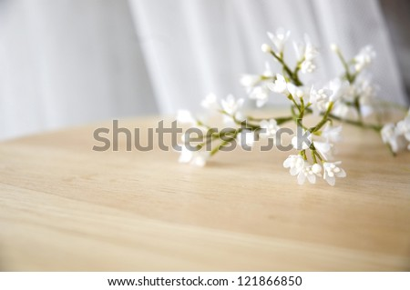 close up white artificial flowers put on table #121866850
