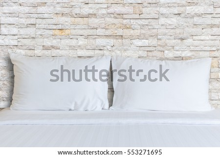 Close up white bedding sheets and pillow in hotel room. #553271695