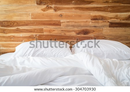 Close up white bedding sheets and pillow, Messy bed concept #304703930