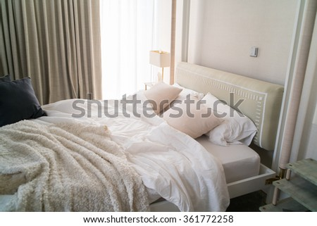 Close up white bedding sheets and pillow, Messy bed concept #361772258