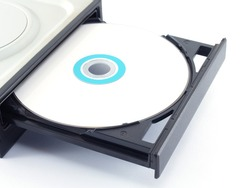 close-up white Cd or Dvd disc in tray on white background, part of hardware for records and storage data for computers