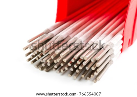 Close up White Covered Arc Welding electrode for Steel in red plastic box isolated on white background.