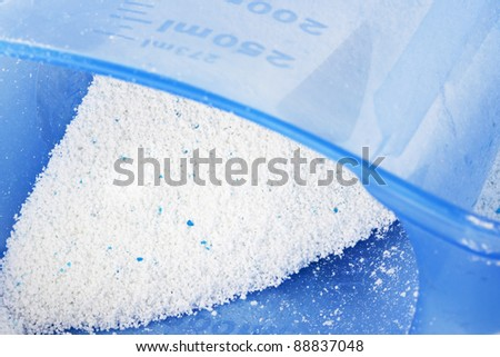 Close up White Detergent in blue cup - stock photo