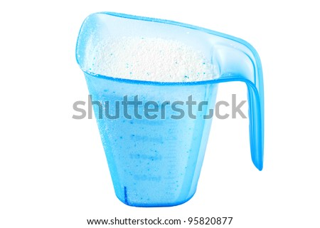 Close up White Detergent in blue cup on the white background