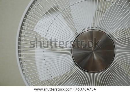 Close-up white fan (electric fan) #760784734