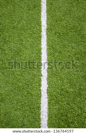 Close up white line on soccer field grass