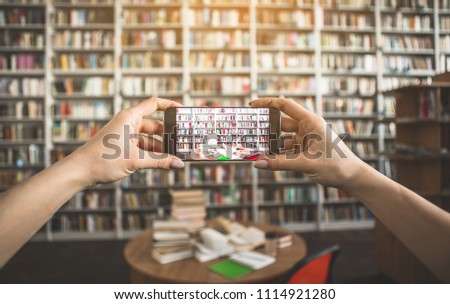 Close up woman arms making picture of volumes, cup of coffee and copybook on desk. She creating it by phone