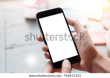 Close up Woman hand Using a Smart Phone with blank screen at cafe coffee shop. Stock photo ©
