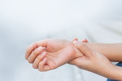 Close up woman holding her wrist symptomatic Office Syndrome