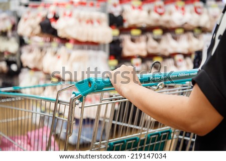 Close up woman shopping in department store
