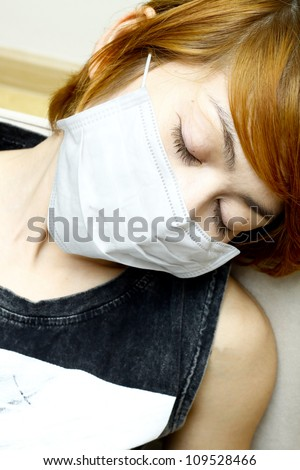close-up woman sleep and wearing protective mask