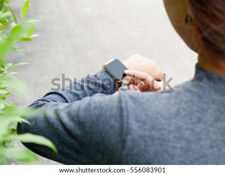 close-up woman using smart watch on hand new modern lifestyle #556083901