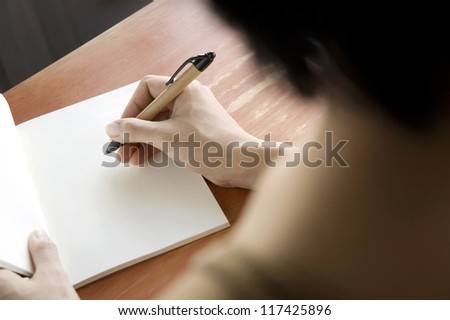 close up woman writing on notebook