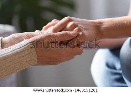 Close up women holding hands, middle aged mother support grown up child showing love and care. Empathy, making peace reconcile after quarrel, parent and adult daughter tender moment together concept