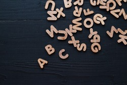 Close up wooden alphabet study english letter,ABC on the blackbroad as a background composition