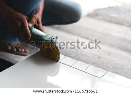 Free Photos Man Cutting A Ceramic Floor Tiles Avopix