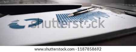 close up. workplace businessman on a black background