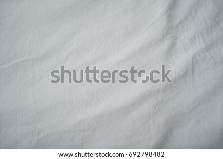 fabric sheet texture. close up wrinkled white fabric bed sheet texture background with writing space. #692798482