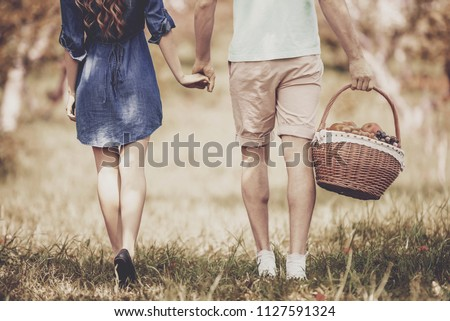 Close up. Young Couple Walking in Summer Park on Sunny Day and Have Romantic Date. Happy Family, Romantic Relationship and Healthy Lifestyle Concepts. Fun Outdoor in Summer Sunny Day Concepts.