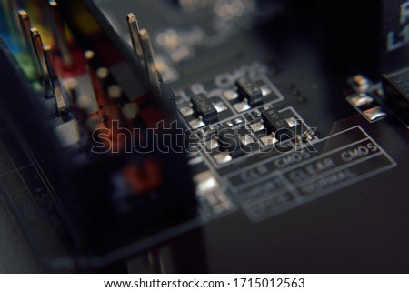 Close up. Young Man Repairing Motherboard from PC. Repair Shop. Worker with Tools. Computer Hardware. Magnifying Glass. Soldering Iron. Digital Device. komputer on Desk. Electronic Devices Concept. Zdjęcia stock ©