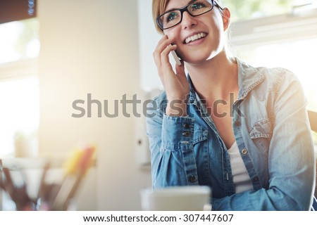 Close up Young Office Woman Talking to Someone on her Mobile Phone While Looking Into the Distance with Happy Facial Expression.