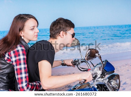 Close up Young Sweet Lovers Riding a Motorbike at the Tranquil Beach on a Tropical Climate. #261680372