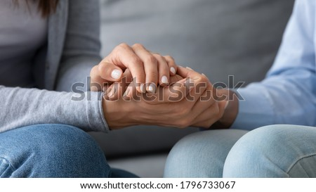 Close up young woman covering hands of mature senior mother, asking for forgiveness, feeling guilty, apologizing indoors. Compassionate grownup daughter comforting supporting retired mum at home. Foto stock ©