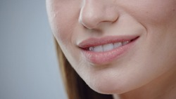 Close up young woman mouth smiling happy beautiful soft lips showing healthy teeth dental lead by hand on the face attractive female happy health cosmetics young slow motion