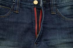 close up zipper of blue jean background