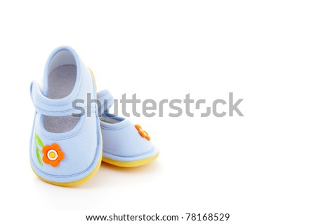 close-ups of blue baby shoes on white - baby stuff