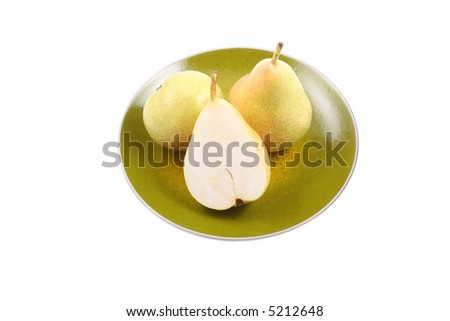 close-ups of two delicious pears on plate isolated on white - stock photo