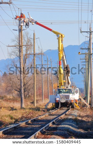 Close, vertical view of a vehicle specially equipped to transport maintenance crews on railway tracks to work on hydro electric lines.