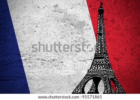 Close view of a grunge French flag illustration with the Eiffel Tower printed.
