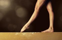 Close view of a Gymnast legs on a balance beam