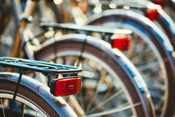 Close View Of A Row Of Identical Vintage Bicycles For Rent At The City Bike Parking On The Street In European Capital